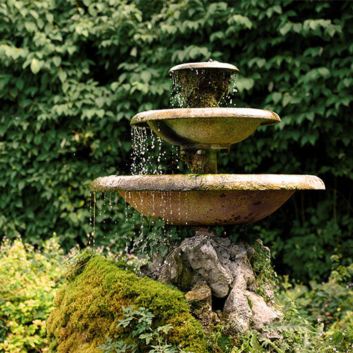 the sound of running water of green garden water fountains